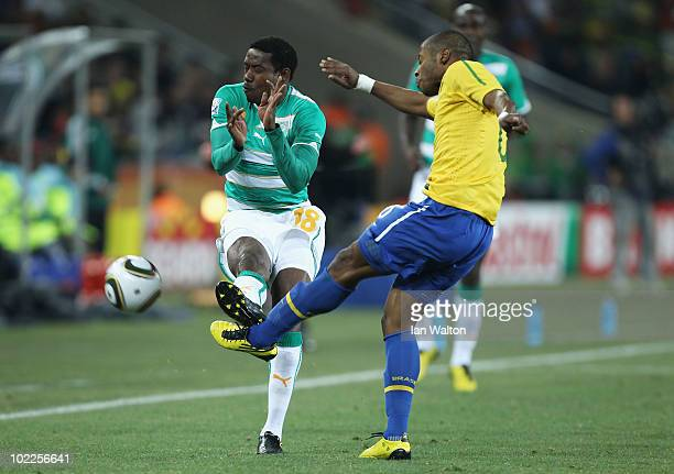 Abdul Kader Keita of Ivory Coast and Michel Bastos of Brazil challenge for the ball during the 2010 FIFA World Cup South Africa Group G match between...