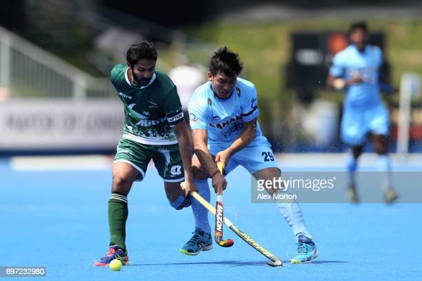 Abdul Khan of Pakistan battles for the ball with Chinglensana Kangujam of India during the Hero Hockey World League Semi Final match between Pakistan...
