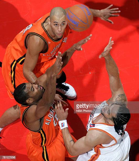 Abdul Mills and James Smith of the Albuquerque Thunderbirds go for a rebound against Luke Whitehead of the Iowa Energy on November 26 2007 at Wells...