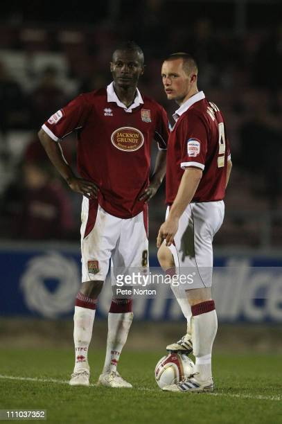 Abdul Osman and Shaun Harrad of Northampton Town look on as they await the referee to start the second half during the npower League Two League match...