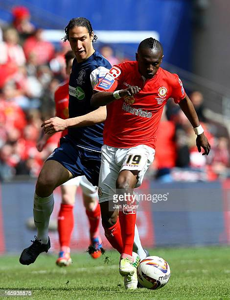 Abdul Osman of Crewe Alexandra battles with Bilel Mohsni of Southend United during the Johnstone's Paint Trophy Final match between Crewe Alexandra...