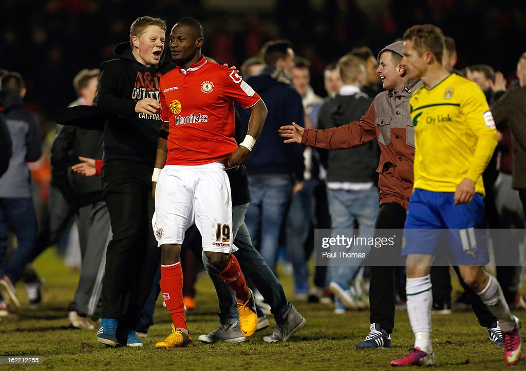 Abdul Osman (C) of Crewe is congratulated by fans at full time of the Johnstone's Paint Trophy Northern Section Final Second Leg match between Crewe Alexandra and Coventry City at the Alexandra Stadium on February 20, 2013 in Crewe, England.