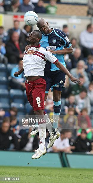 Abdul Osman of Northampton Town challenges for the ball with Leon Johnson of Wycombe Wanderers during the npower League Two League match between...