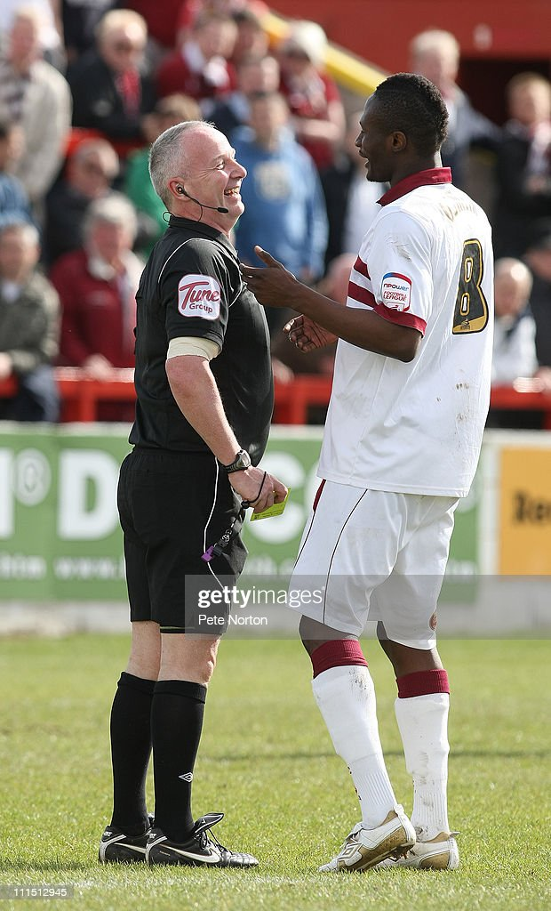 Abdul Osman of Northampton Town shares a joke with referee Phil Gibbs prior to being shown a yellow card during the npower League Two League match between Accrington Stanley and Northampton Town at the Crown Ground on April 2, 2011 in Accrington, England.