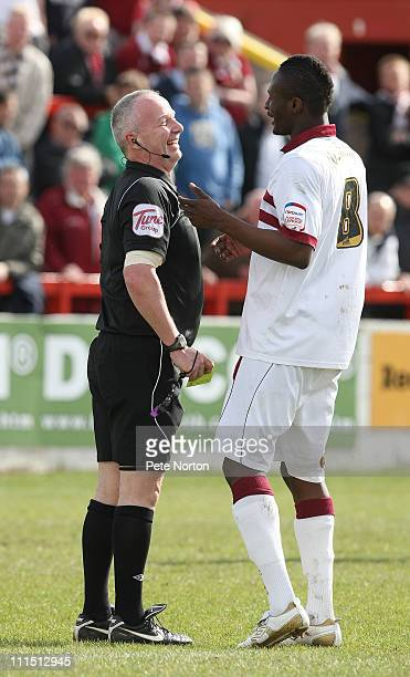 Abdul Osman of Northampton Town shares a joke with referee Phil Gibbs prior to being shown a yellow card during the npower League Two League match...