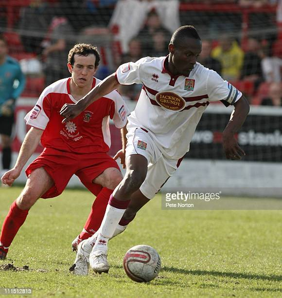 Abdul Osman of Northampton Town turns away with the ball watched by Luke Joyce of Accrington Stanley during the npower League Two League match...