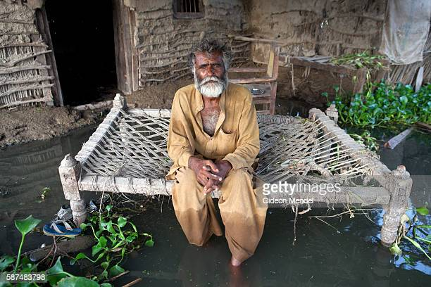 Abdul Rahim is photographed outside his flooded house on the outskirt of Sujawel about a month after the area was flooded The water came at 4 pm and...