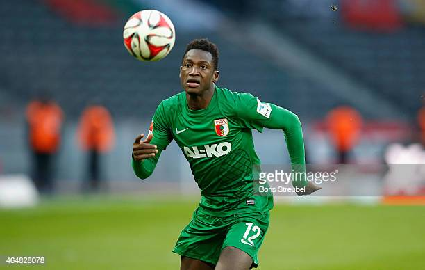 Abdul Rahman Baba of Augsburg runs with the ball during the Bundesliga match between Hertha BSC and FC Augsburg at Olympiastadion on February 28 2015...