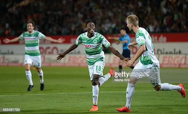 Abdul Rahman Baba of Fuerth celebrates with teammates after scoring his team's third goal during the Bundesliga match between Greuther Fuerth and 1...