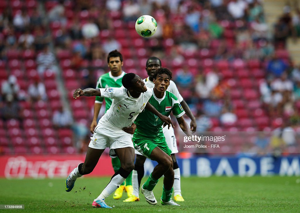 Abdul Rahman Baba (L) of Ghana and Jawad Kadhim of Iraq compete for the ball during the FIFA U-20 World Cup 3rd Place playoff match between Ghana and Iraq at Ali Sami Yen Arena on July 13, 2013 in Istanbul, Turkey.