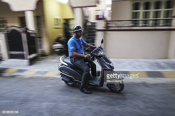 Abdul Saleem a deliveryman known as a Wishmaster for Flipkart Online Services Pvt's Ekart Logistics service rides a motorcycle to work in Bengaluru...