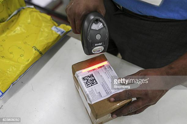 Abdul Saleem a deliveryman known as a Wishmaster for Flipkart Online Services Pvt's Ekart Logistics service scans the barcode on a package at the...