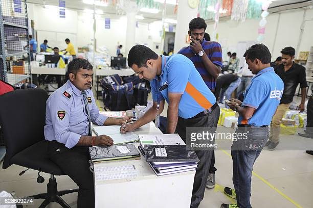 Abdul Saleem a deliveryman known as a Wishmaster for Flipkart Online Services Pvt's Ekart Logistics service signs in at a security desk at the...