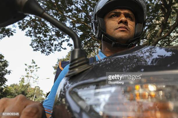 Abdul Saleem a deliveryman known as a Wishmaster for Flipkart Online Services Pvt's Ekart Logistics service rides a motorcycle while delivering...