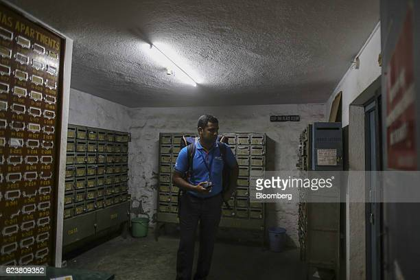 Abdul Saleem a deliveryman known as a Wishmaster for Flipkart Online Services Pvt's Ekart Logistics service walks past mailboxes as he delivers a...