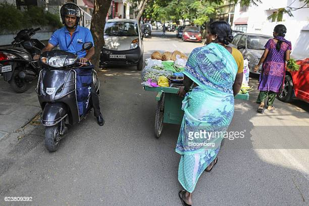 Abdul Saleem a deliveryman known as a Wishmaster for Flipkart Online Services Pvt's Ekart Logistics service left rides a motorcycle while delivering...