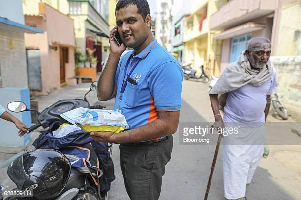 Abdul Saleem a deliveryman known as a Wishmaster for Flipkart Online Services Pvt's Ekart Logistics service uses a smartphone in Bengaluru India on...