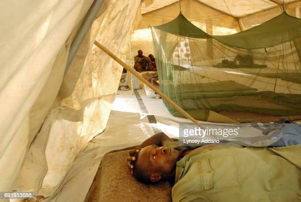Abdul Sbir Ahmad a Sudanese government soldier lies wounded in a tent on the ground of a local hospital in Iriba in northeastern Chad October 14 2006...
