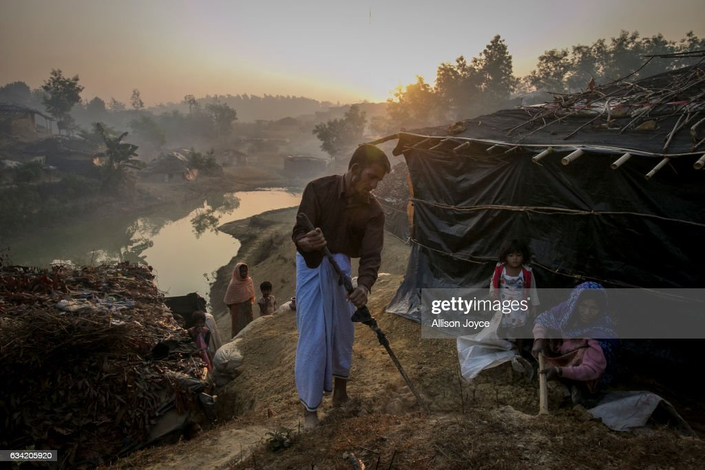 COX'S BAZAR, BANGLADESH - FEBRUARY 8: Abdul Shukor works on his home in Kutapalong Rohingya refugee camp on February 8, 2017 in Cox's Bazar, Bangladesh. Shukor fled to Bangladesh 2 months ago from Rasidon village after the military attack to their village. The military cut the throat and killed his 18 year old son before his eyes. They feel safe now The United Nations estimates about 69,000 Rohingya Muslims have fled to Bangladesh from Myanmar since October last year after the Burmese army launched a campaign it calls 'clearance operations' in response to an attack on border police. Based on reports, Bangladesh plans to proceed with a controversial plan to relocate tens of thousands of Rohingya refugees from Myanmar to a remote island in Bay of Bengal, despite warnings it is uninhabitable and prone to flooding. Waves of Rohingya civilians have fled across the border since last year, most living in makeshift camps and refugee centers with harrowing stories on the Burmese army committing human-rights abuses, such as gang rape, arson and extrajudicial killing. The Rohingya, a mostly stateless Muslim group numbering about 1.1 million, are the majority in Rakhine state and smaller communities in Bangladesh, Thailand and Malaysia.