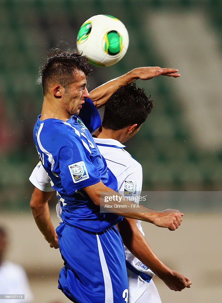 Abdulaziz Ashurmatov (front) of Uzbekistan jumps for a header with Brayan Velasquez of Honduras during the FIFA U-17 World Cup UAE 2013 Round of 16 match between Honduras and Uzbekistan at Sharjah Stadium on October 28, 2013 in Sharjah, United Arab Emirates.