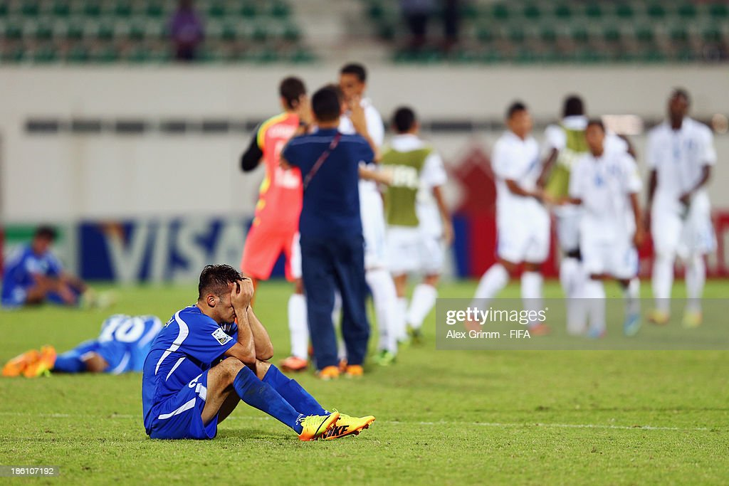 Abdulaziz Ashurmatov (front) of Uzbekistan reacts after the FIFA U-17 World Cup UAE 2013 Round of 16 match between Honduras and Uzbekistan at Sharjah Stadium on October 28, 2013 in Sharjah, United Arab Emirates.