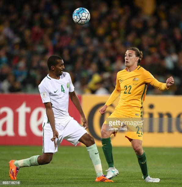 Abdulla Aldossary of Saudi Arabia competes with Jackson Irvine of Australia during the 2018 FIFA World Cup Qualifier match between the Australian...