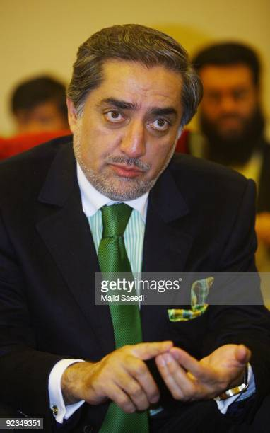 Abdullah Abdullah former Afghan foreign minister who challenged President Hamid Karzai in last August's vote arrives to attend a meeting with his...