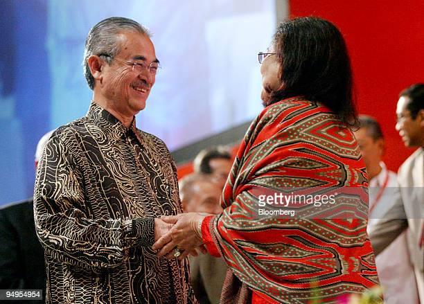 Abdullah Ahmad Badawi Malaysia's prime minister left greets United Malays National Organisation's Women's Wing head Rafidah Aziz prior to his address...