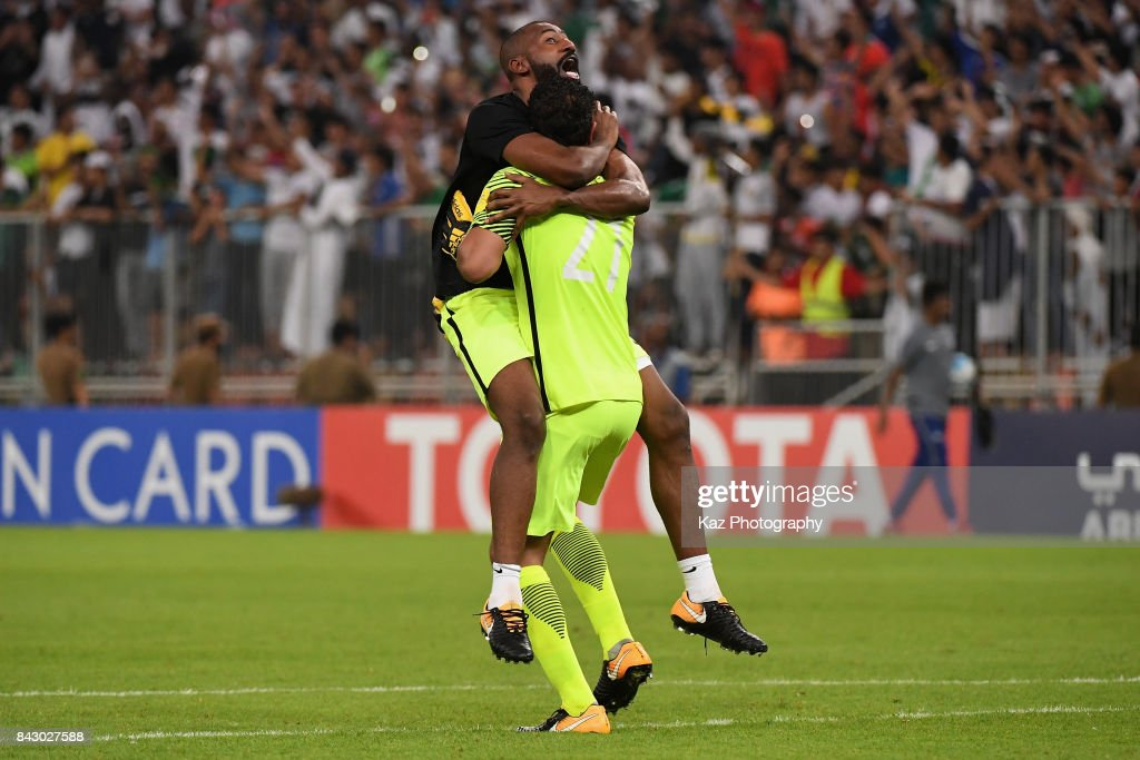 Abdullah Almayouf (R) and Waleed Abdullah (L) of Saudi Arabia celebrate their 1-0 victory and qualified for the FIFA World Cup Russia after the FIFA World Cup qualifier match between Saudi Arabia and Japan at the King Abdullah Sports City on September 5, 2017 in Jeddah, Saudi Arabia.