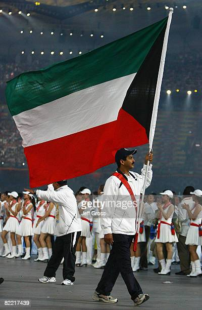 Abdullah Alrashidi of Kuwait carries his country's flag during the Opening Ceremony for the 2008 Beijing Summer Olympics at the National Stadium on...