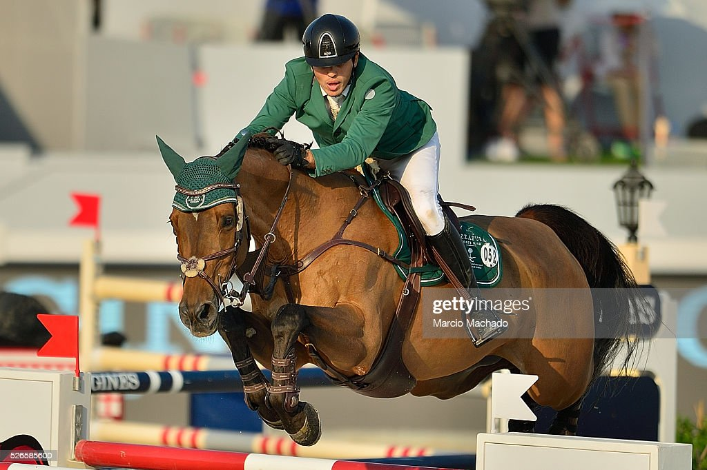 Abdullah Alsharbatly of Saudi Arabia hiding Tobalio during the Longines Global Champions Tour of Shanghai day 2 jump-off 1.60 m height on on April 30, 2016 in Shanghai, China.