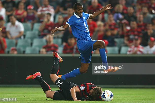 Abdullah Alsudairi of Al Hilal jumps over the tackle of Daniel Mullen of the Wanderers during the Asian Champions League final match between the...