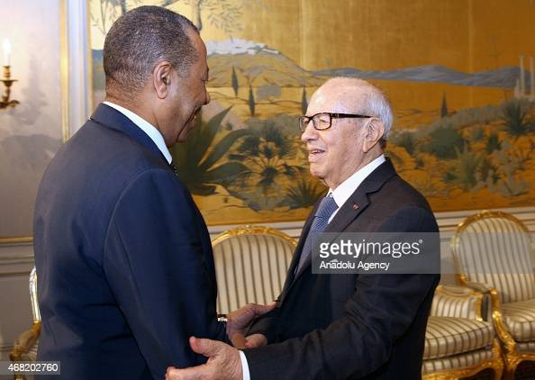 Abdullah alThinni Prime Minister of Libya's Tobrukbased government is welcomed by Tunisian President Beji Caid Essebsi prior to their meeting at the...