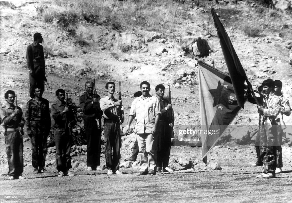 Abdullah Öcalan (white suit), leader of the PKK, is taking the salute of his guerilla fighters in Kurdistan