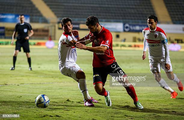 Abdullah Elsaid of Al Ahly in action against Tarek Hamed of Zamalek during the Egypt Premier League match between Al Ahly and Zamalek at the Petro...
