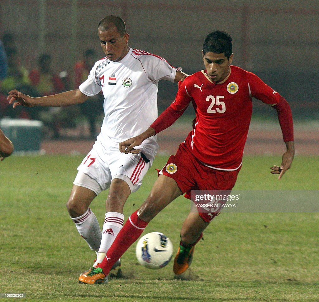 Abdullah Helal (R) of Bahrain vies for the ball against Munassar Ba Haj of Yeman during their football match in the 7th West Asia Football Federation (WAFF) championship in Kuwait City on December 9, 2012.