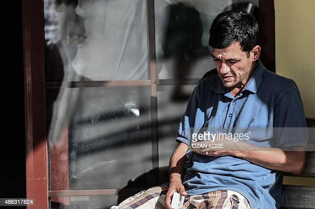 Abdullah Kurdi father of threeyear old Aylan Kurdi waits at the morgue in Mugla southern Turkey on September 3 after a boat carrying refugees sank...