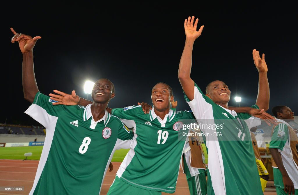 Abdullahi Alfa, Zaharaddeen Bello and Musa Yahaya of Nigeria celebrate their teams win at the end of the round of 16 match between Nigeria and Iran at Khalifa Bin Zayed Stadium on October 29, 2013 in Al Ain, United Arab Emirates.