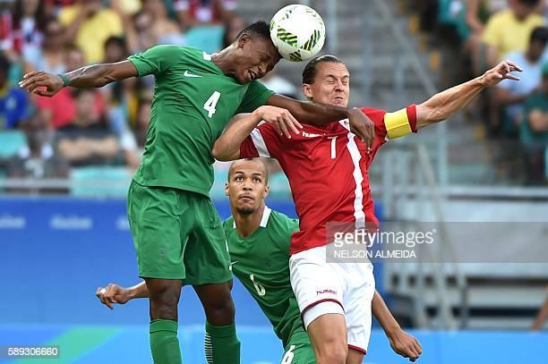 Abdullahi Shehu of Nigeria vies for the ball with Lasse Vibe of Denmark during the Rio 2016 Olympic Games mens quarterfinal football match Nigeria vs...