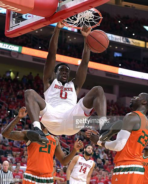 AbdulMalik Abu of the North Carolina State Wolfpack dunks the ball against Tonye Jekiri of the Miami Hurricanes at PNC Arena on January 30 2016 in...