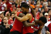 AbdulMalik Abu of the North Carolina State Wolfpack hugs Ralston Turner of the North Carolina State Wolfpack in the second half of the game against...