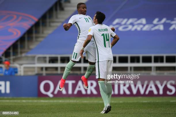 Abdulrahman Alyami of Saudi Arabia celebrates with his team mate Ali Alasmari after scoring his teams second goal during the FIFA U20 World Cup Korea...