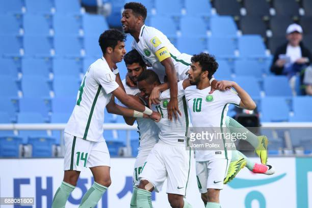 Abdulrahman Alyami of Saudi Arabia celebrates with his team mates after scoring his team's first goal during the FIFA U20 World Cup Korea Republic...