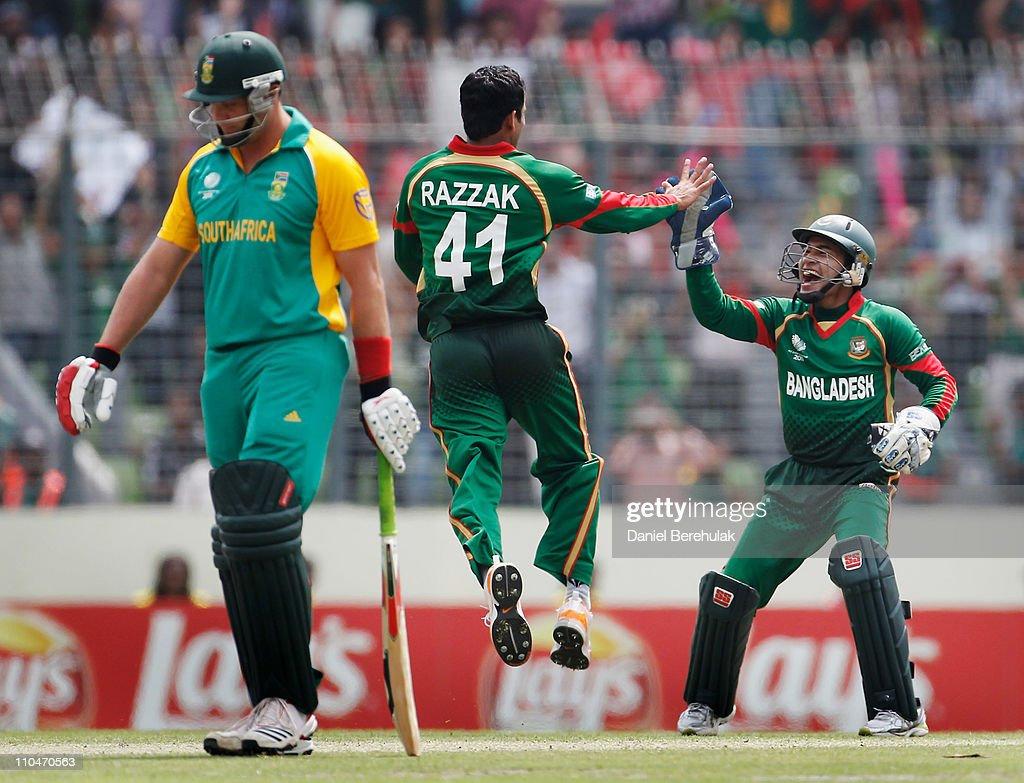 Abdur Razzak of Bangladesh celebrates with teammate <a gi-track='captionPersonalityLinkClicked' href=/galleries/search?phrase=Mushfiqur+Rahim&family=editorial&specificpeople=835117 ng-click='$event.stopPropagation()'>Mushfiqur Rahim</a> after bowling Hashim Amla of South Africa (unseen) during the ICC World Cup Cricket Group B match between Bangladesh and South Africa at Shere-e-Bangla National Stadium on March 19, 2011 in Dhaka, Bangladesh.