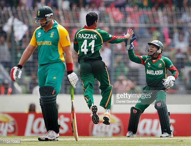 Abdur Razzak of Bangladesh celebrates with teammate Mushfiqur Rahim after bowling Hashim Amla of South Africa during the ICC World Cup Cricket Group...