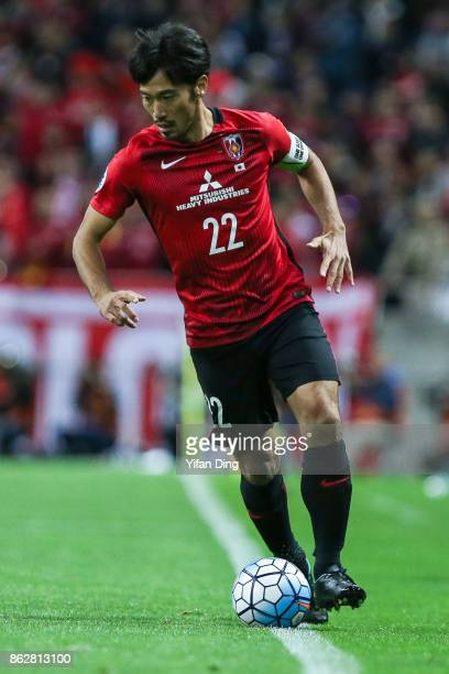 Abe Yuki of Shanghai SIPG in action during the AFC Champions League semi final second leg match between Urawa Red Diamonds and Shanghai SIPG at...