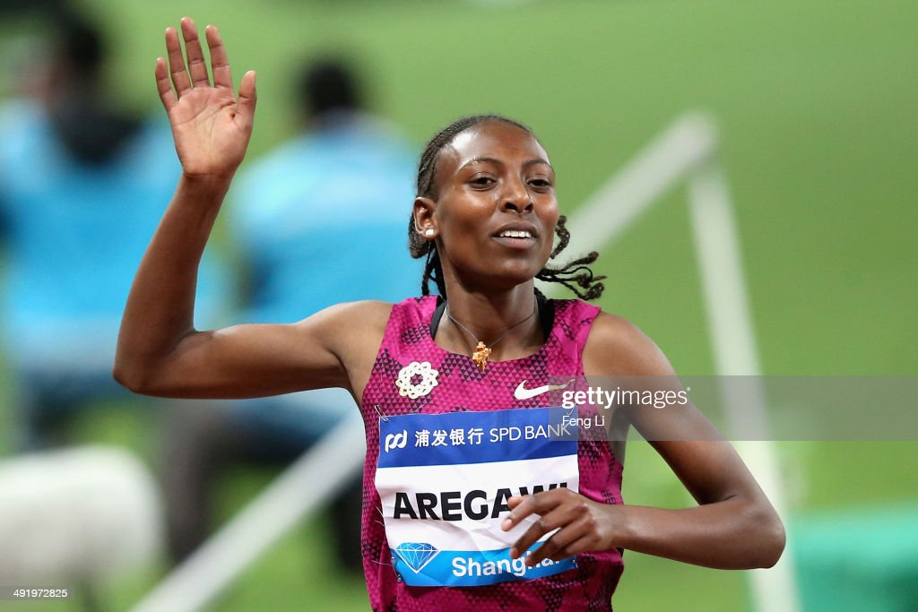 <a gi-track='captionPersonalityLinkClicked' href=/galleries/search?phrase=Abeba+Aregawi&family=editorial&specificpeople=7507662 ng-click='$event.stopPropagation()'>Abeba Aregawi</a> of Sweden celebrates after crossing the finishing line during the Women 1,500m of the Diamond League Track and Field competition on May 18, 2014 in Shanghai, China.