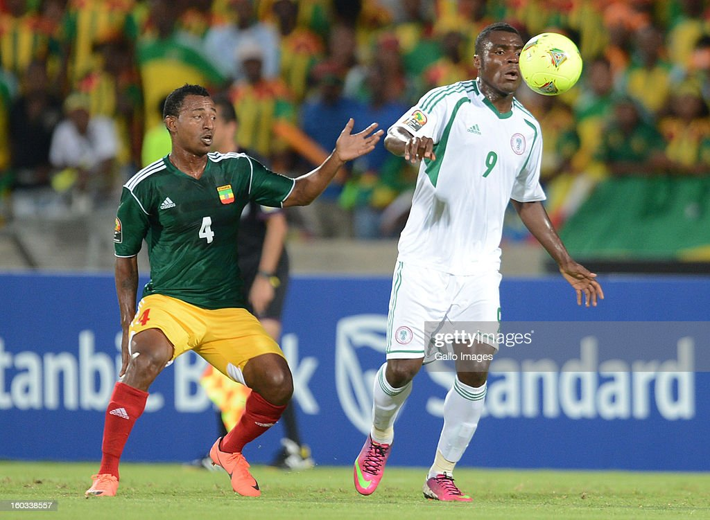 AFRICA - JANUARY 29, Abebaw Butako of Ethiopia and Emmanuel Emenike of Nigeria (R) during the 2013 African Cup of Nations match between Ethiopia and Nigeria at Royal Bafokeng Stadium on January 29, 2013 in Rustenburg, South Africa.