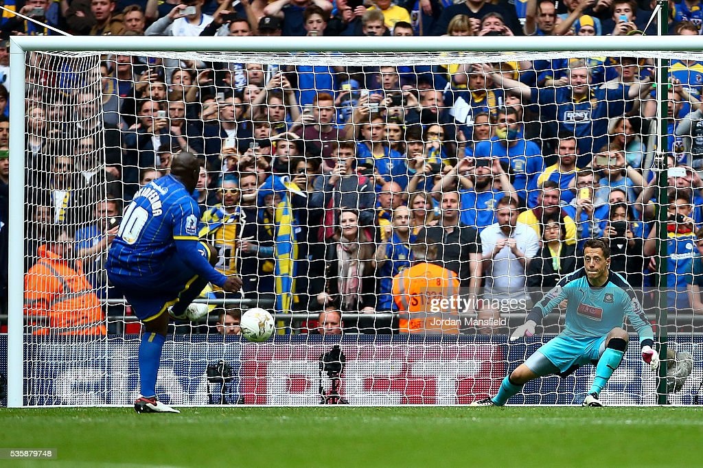 Abebayo Akinfenwa of Wimbledon scores his sides second goal from a penalty during the Sky Bet League Two Play Off Final match between Plymouth Argyle and AFC Wimbledon at Wembley Stadium on May 30, 2016 in London, England.