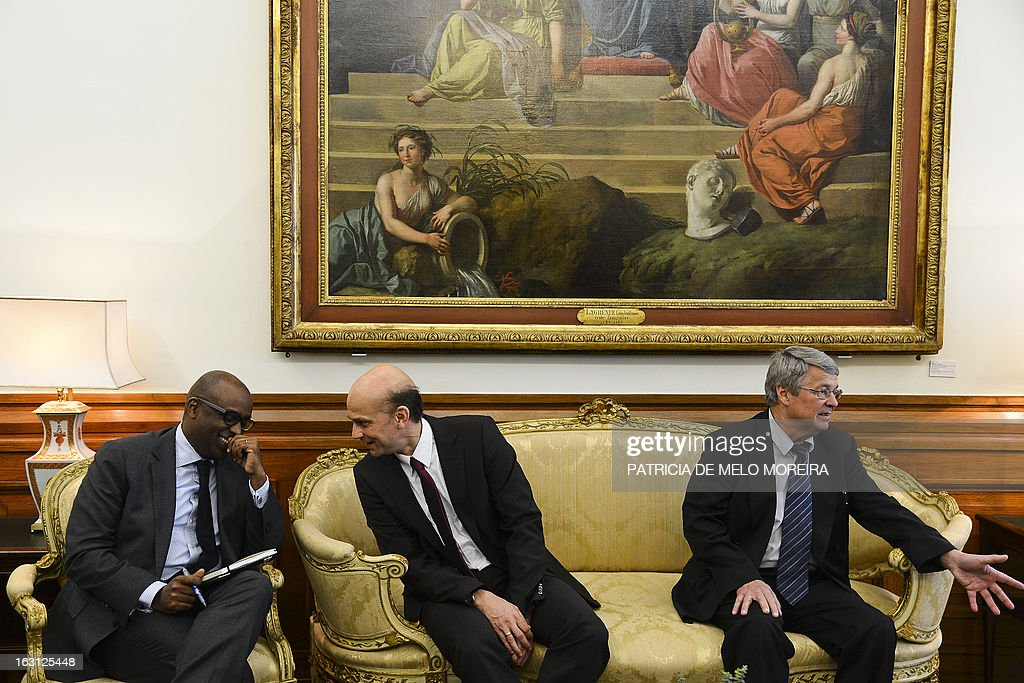 Abebe Selassie, International Monetary Fund (IMF) mission chief for Portugal, Rasmus Ruffer, head of the European Central Bank (ECB) delegationto Portugal, Jurgen Kroger, head of European Union (EU) delegationn (EU) attend a meeting with the President of the Portuguese Parliament Assuncao Esteves (unseen) in Lisbon on February 21, 2012.